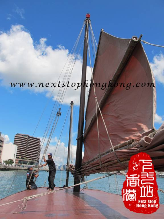 The Duk Ling Crew prepares the sails