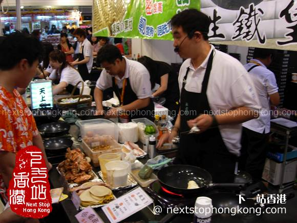Visitors are testing food in Food Expo