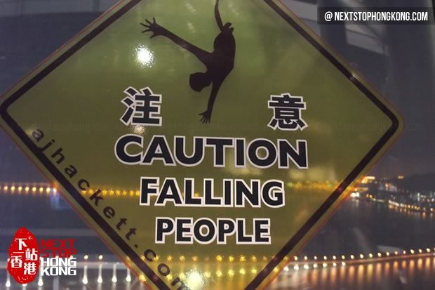 Falling People Sign in Macau Tower
